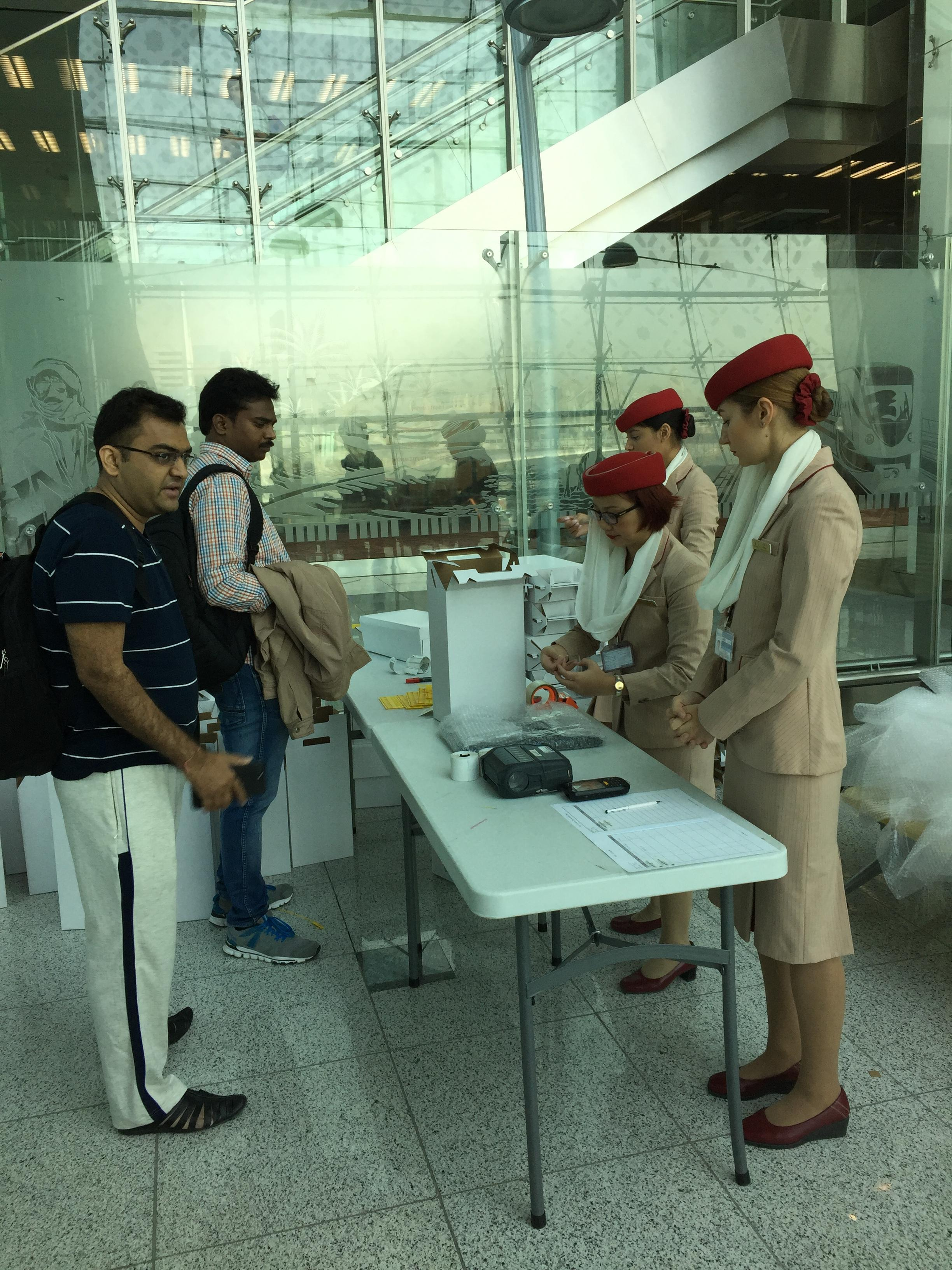 Emirate staff packing laptops.jpg